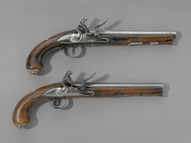 A pair of silver-mounted English flintlock pistols by Joseph Griffin