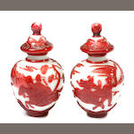 A pair of red and white Peking glass covered vases