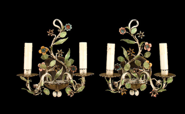 A pair of polychrome decorated metal two light wall appliques<BR />20th century