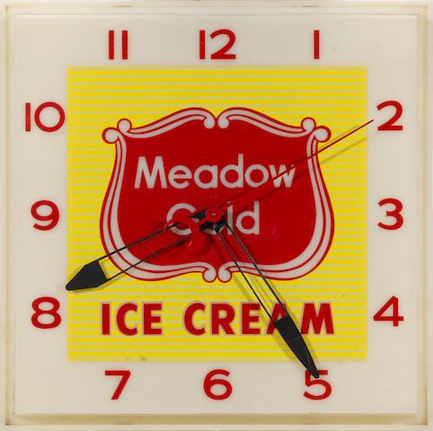 A illuminated Medow Gold Ice Cream Clock,