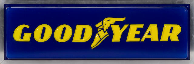An illuminated Goodyear tires sign,