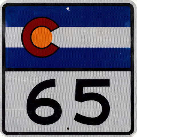A Colorado highway 65 sign,
