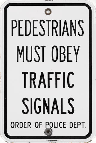 A 'Pedestrian Must Obey' sign,
