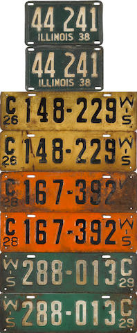 A collection of pre-war licence plates,