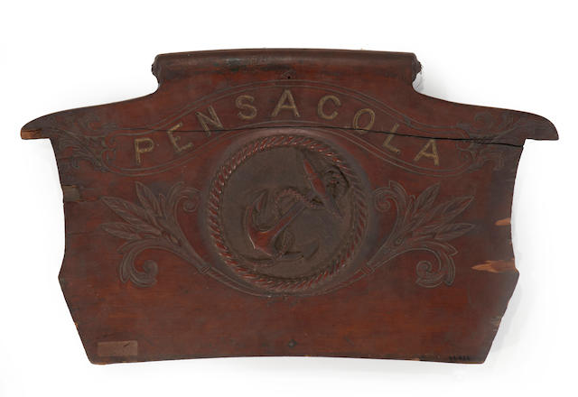 A coxswain's carved seatback for a launch from the USS Pensacola  circa 1860 16 x 28 in. (41 x 71 cm.) height x width.