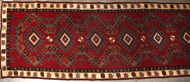 A Turkish runner size approximately 2ft. 9in. x 13ft. 5in.