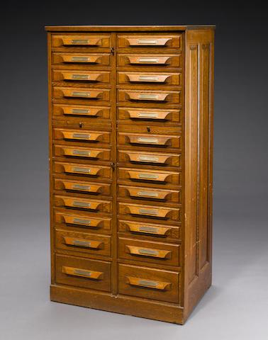 An oak specimen cabinet