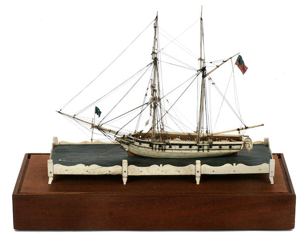 An ivory POW ship model in plexiglass and wooden case