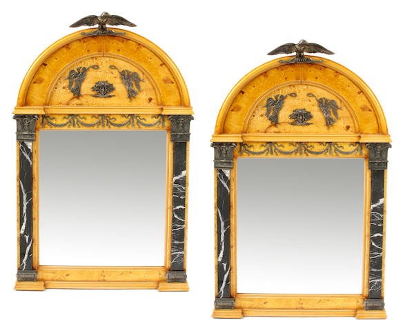 A pair of Empire style bronze and marble mounted mirrors