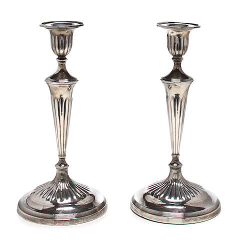 A pair of George III sterling silver partially reeded candlesticks<BR />John Green & Co., Sheffield, 1799