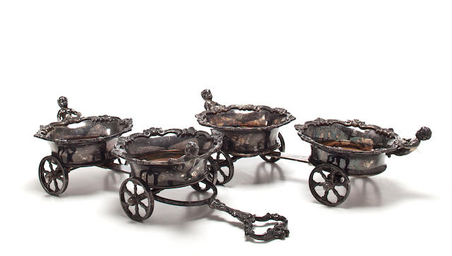 A large pair of silverplate figural trolleys