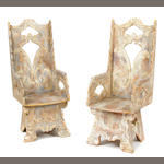 A pair of Continental carved and paint decorated armchairs