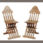 A pair of Moroccan bone inlaid folding chairs