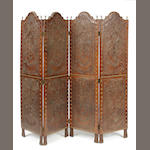 A Spanish Baroque style four panel embossed leather floor screen