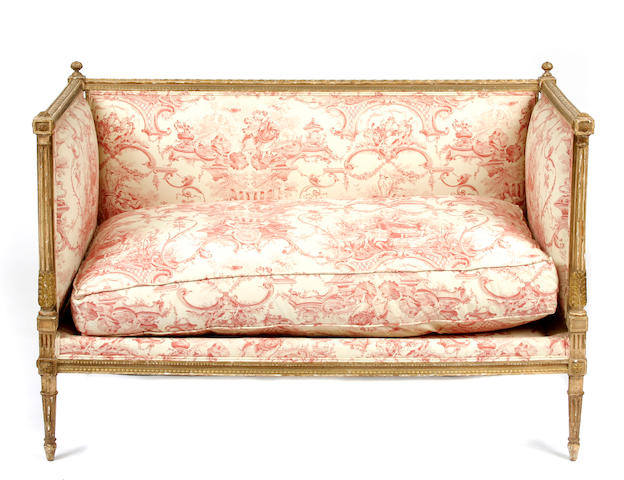 A Louis XVI style paint decorated and parcel gilt settee