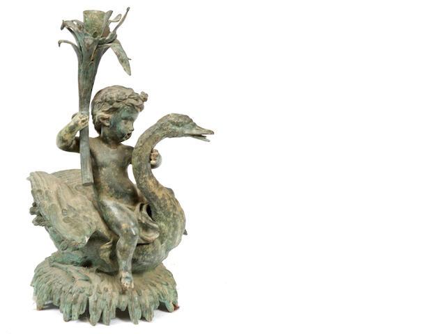 A Luciano bronze figural candlestick