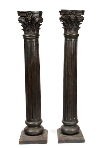 A pair of paint decorated columns with Corinthian capitals