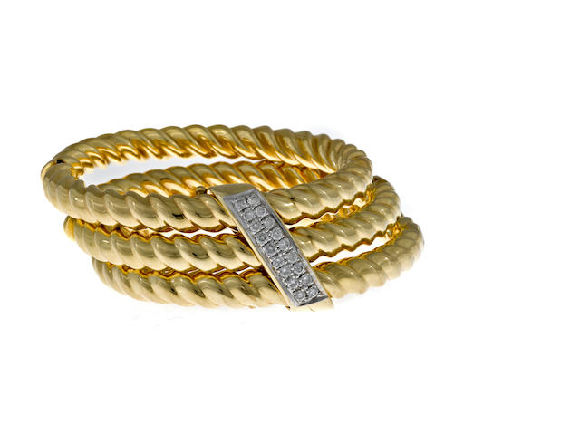 A diamond and fourteen karat gold three row bangle bracelet