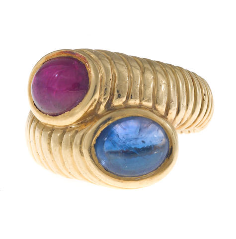 A ruby and sapphire bypass ring ***test gold quality; acids w Harry***