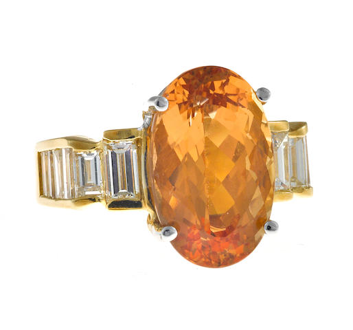A topaz and diamond ring