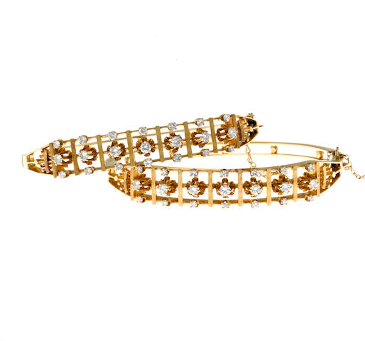A pair of diamond bangle bracelets