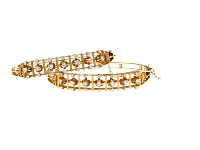 A pair of diamond bangle bracelets
