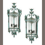 A pair of Victorian style patinated bronze lanterns