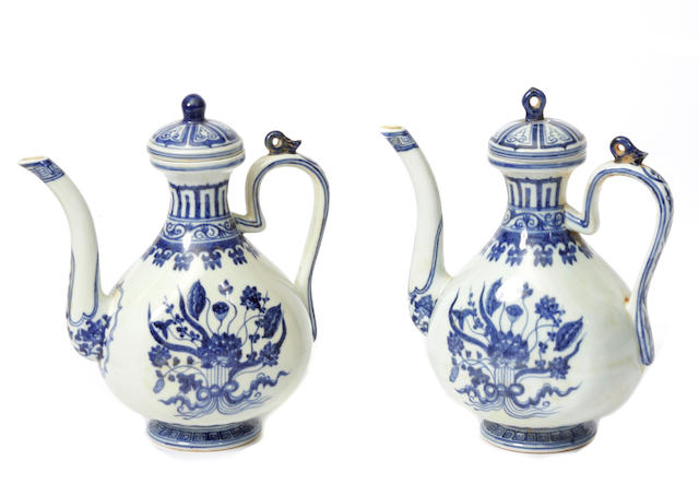 A pair of Chinese blue and white porcelain covered ewers