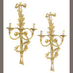 A pair of Louis XVI style gilt bronze three light bras de lumiere