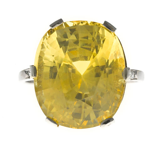 A yellow sapphire and diamond ring,