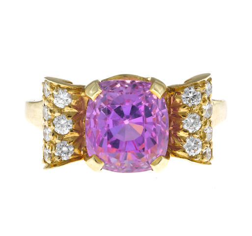 A pink sapphire and diamond scroll motif ring