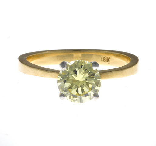 A yellow diamond solitaire ring