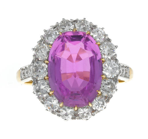 A pink topaz and diamond ring