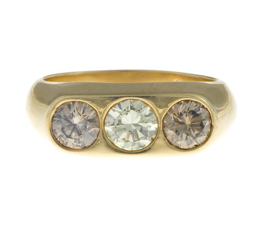 A colored diamond three-stone ring