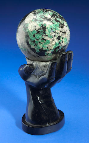Emerald in matrix sphere on stand