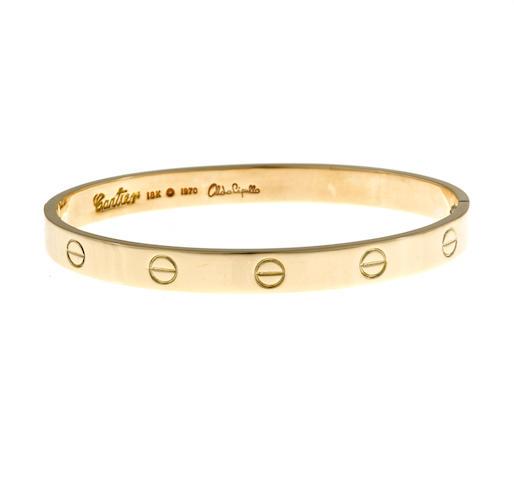 """An eighteen karat gold """"Love"""" bangle bracelet, Aldo Cipullo, Cartier, 1970"""