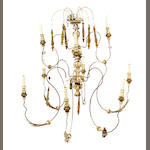 A French Neoclassical style wood and metal twelve light chandelier