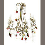 A Rococo style patinated metal gilt tôle and colored glass six light chandelier