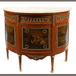 A Louis XV style gilt bronze mounted paint decorated commode