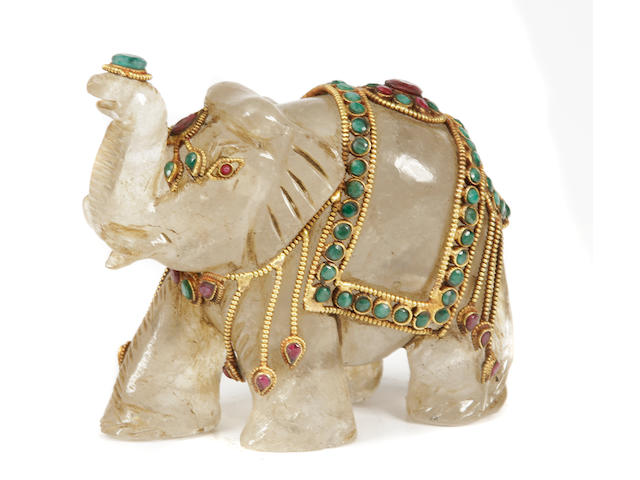 A Southeast Asian style gilt and gemstone mounted rock crystal elephant
