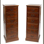 A pair of Chinese hardwood six drawer cabinets