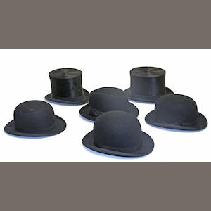 A group of four top hats, three bowler hats, one soft brim, and a leather hat box