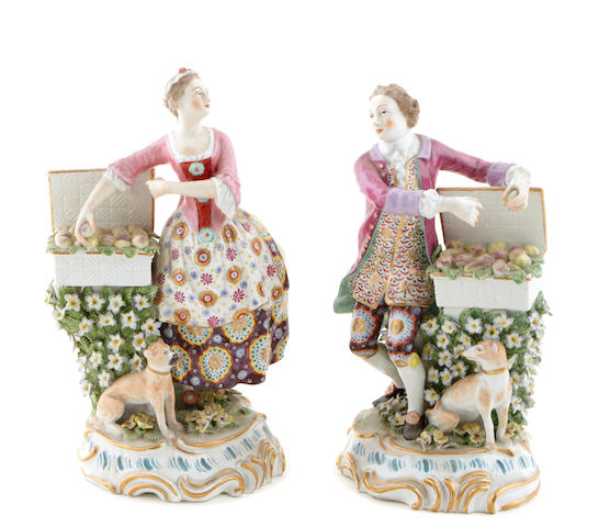 A pair of Continental Rococo style porcelain figures