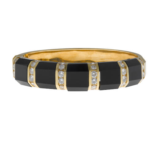 A black onyx and diamond bangle bracelet