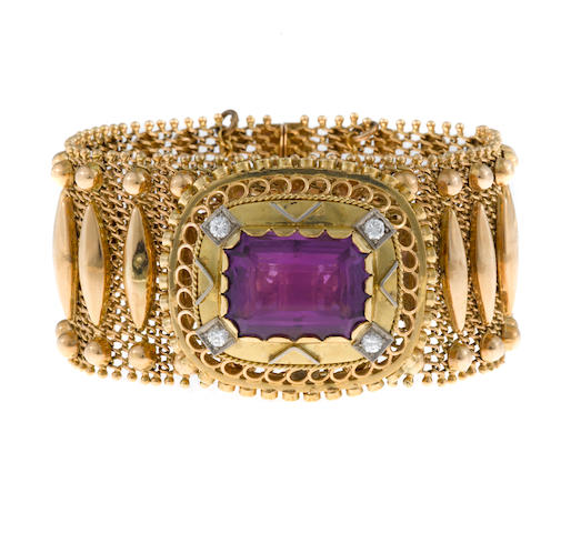 An amethyst and fourteen karat gold strap bracelet