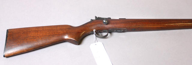 A Winchester Model 69 bolt action rifle