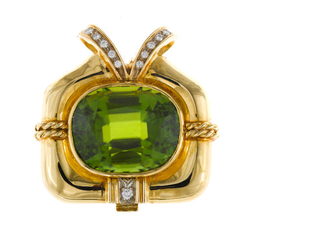 A peridot and diamond pendant