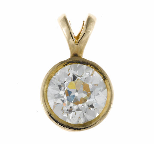 A diamond solitaire pendant