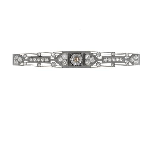 A colored diamond and diamond bar brooch