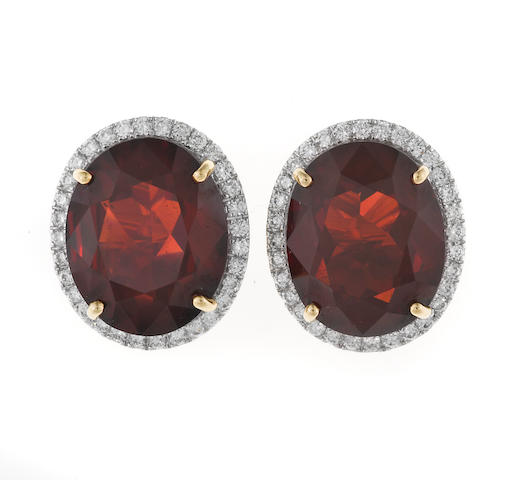 A pair of garnet and diamond earclips